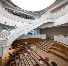 The flooring on three floors and a circular Auditorium of stairs, were wrapped all around in bamboo flooring boards.