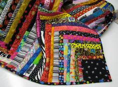 Make this stashbuster rainbow quilt! Start with one square and work outward for a great project. Home dec? Full quilt? Up to you!