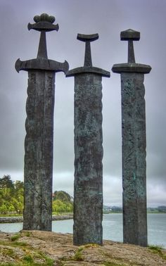 Viking Swords at Stavanger Swords Monument, Stavanger, Norway area near the seashore where a tremendous battle took place back during the age of the Vikings. This battle apparently helped unify the country. These swords are 10 meters tall.... From Stavanger-Web.com Three enormous bronze swords stand monument to the battle of Hafrsfjord in the year 872, when Harald Hårfagre (Fairheaded Harald) united Norway into one kingdom. Designed by Fritz Røed and unveiled by Norway's King Olav in 1983