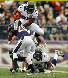 f651038ab16 Denver Broncos running back Knowshon Moreno (27) hurdles Baltimore Ravens  safety Ed Reed (