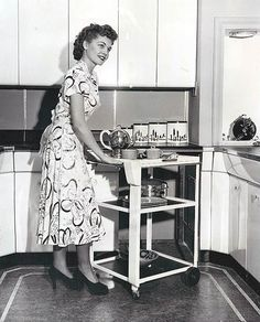 The gleaming kitchen, her dress, that serving cart, her curly hair...love all of it. #vintage #1940s #homemaker #housewife #hostess #kitchen