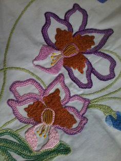 Parte de um quadrado para colcha feita em bordado livre