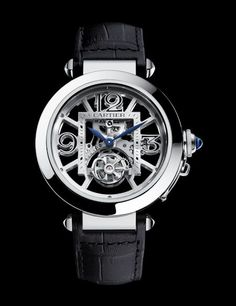 Pasha de Cartier Skeleton Flying Tourbillion. This model has a diameter of 42mm and a Geneva Seal movement where empty space contrasts with depth and textures created by hand-applied finishes such as beveled bridges, satin-brushed sides and circular-grained wheels.