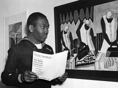 "Legendary artist Jacob Lawrence in his days as a Coastguardsman on March 27, 1945 in Boston. He was at the Institute of Modern Art in Boston for a showing of his paintings (he is shown with one of his most famous works, ""Ironers,"" a gouache on paper from 1943. Photo: Bettman/Corbis"