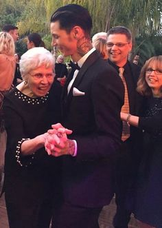 His mom and dad are even in the background. I'm assuming this is from his wedding