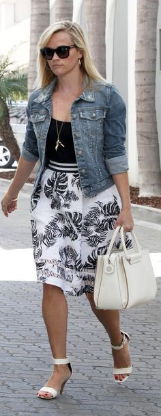Reese Witherspoon street style: The star stepped out  wearing a Summery leaf print skirt, white heels, and a jean jacket