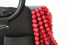 This is a Mini Victoria bag and Big Apple Red necklace from Fairchild Baldwin. #leather #beads #handbag #bag #designerbag #jewelry #necklace #fairchildbaldwin