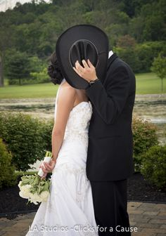 A Secret Kiss at a Cowboy Wedding Portrait                                         Could use brides flowers