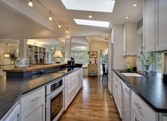 Open Contemporary White Kitchen | Cultivate, looks easy to clean, like track lighting.
