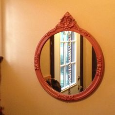 trash picked antique round mirror, painted it orange once I got it home.