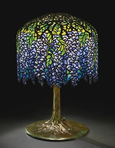 """""""WISTERIA"""" TABLE LAMP shade with small early tag impressed TIFFANY STUDIOS/NEW YORK  leaded glass and patinated bronze  26  7/8  in. (68.2 cm) high 17  3/4  in. (45.1 cm) diameter of shade  circa 1905"""