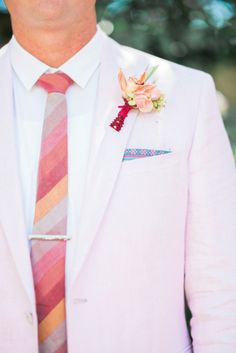 pink suit and a bold tie