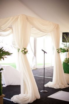 Chuppah  i like the simple design but with different maybe a little bigger flowers and a talit hanging from the center underneath  http://rosechairdecor.com/linens-rentals