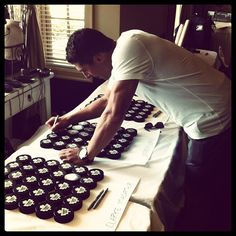 Joffrey Lupul signining pucks that were auctioned off at the golf classic.