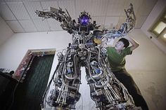 Chinese inventor Tao Xiangli tinkers with his homemade robot at his house in Beijing on May 15. Tao, 37, spent about $24,400 to build the 7-foot robot out of scrap metal and electric wires he found at second-hand markets. The 500-pound robot took almost a year to complete. This is not Taos first invention: Several years ago he built a fully functioning submarine