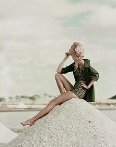 vintage everyday: Beautiful Color Fashion Shoots of Women's Bathing Suits in the 1950's Model is in a tank-top swimsuit in moss green lace over white broadcloth and a beach coat with zipped front. Photo by Leombruno-Bodi, appeared in the May 1954 Glamour.