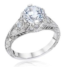 Classic vintage engagement ring with diamond accents available at Emma Parker & Co.