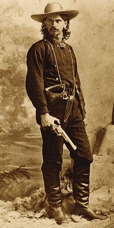 Wild Ben Raymond, who worked as a mine guard, posed for his photograph in Leadville, Colorado, holding a First Model open top Merwin Hulbert Frontier Army revolver. Although the arm is believed to have been a photographer's prop, it nonetheless shows the Merwin's presence in the Wild West.– Courtesy Robert G. McCubbin Collection –