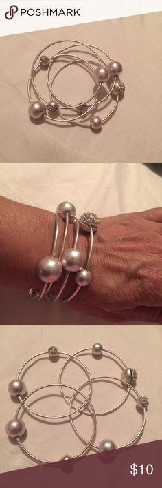 Bracelets Set of four bracelets/bangles with pearls and rimes tones. Jewelry Bracelets