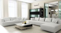 Modern living room with wall-mounted ductless unit | Ductless Home System from Mitsubishi Comfort #energysaver #heating #cooling