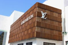 Luxury brand Louis Vuitton uses Accoya® wood for stunning new store exterior façade. Timber Battens, Timber Cladding, Exterior Cladding, Wooden Facade, Shop Facade, Indoor Swing, Wood Store, Interior Design Magazine, Shop Window Displays