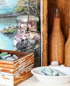 Place shells and beach finds in boxes, bowls, and jars and create a beautiful vignette: http://beachblissliving.com/vacation-memories-photo-display-shell-decor-ideas/