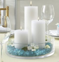 White candles with blue beads