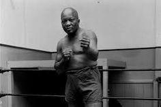 jack johnson  http://memoirsofanurbangentleman.com/tupac-shakur-smile-ft-jack-johnson-first-black-world-heavyweight-champion/