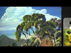 How to paint leaves on trees wet-on-wet in oils or acrylic is explained more at   http://paintwithlen.com/paint-leaves/  Australian landscape artist Len Hend shows you an easy technique of double loading the brush and dabing the paint so as to produce lifelike leaves. This method of painting has been developed by Len. The technique shown here ca...