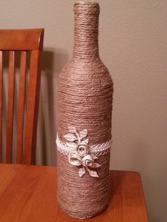 Twine bottle with paper art