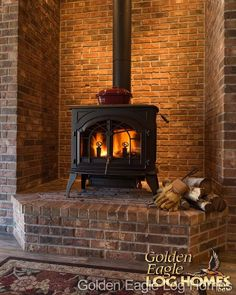 Beautiful free-standing wood stove in our Pool House/Pub. Photos and floor plans are at www.GoldenEagleLogHomes.com #loghomeliving #construction #loghomes #loghome #logcabins #cabin #logcabins #home #homes #houzz #outdoors #nature #rusticliving