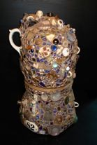 Memory jugs are mosaic vessels covered in mortar and encrusted with shards, shells, and various found objects. They were popular in victorian times as folk art but the idea is believed to have originated from African mourning vessels.