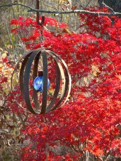 http://www.fleamarketgardening.org/wp-content/uploads/2013/11/Sphere-made-from-barrel-rings.jpg