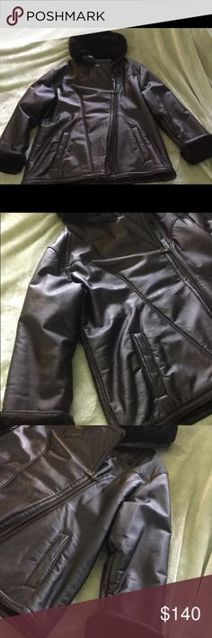 Woman's XL leather coat with faux fur Wilson's XL black leather coat faux fur is missing belt but zips and excellent condition smoke free home. Hood and inside lined with vey soft faux fur Wilsons Leather Jackets & Coats