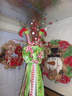 Elf Legs Christmas Tree Topper by DecoMeshObsession on Etsy, $100.00