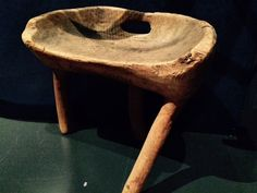 Finnish stool made from log with branches still attached.  National Museum