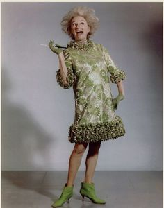 Comedian Phyllis Diller in her lime green costume from the 1967 USO tour. Looking the part of a zany housewife helped her challenge the idealized view of women as objects of beauty.