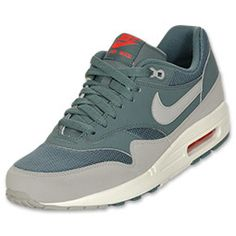 The Nike Air Max 1 Essential Men's Running Shoes remain iconic. The premium men's shoes are dressed in a leather and mesh upper for a durable yet breathable look. A pop of color wraps around the shoes and is on the Swoosh while a white midsole keeps things anchored. The look is completed with a heel Air Max unit for superior cushioning.