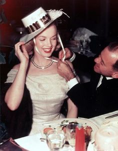Marilyn photographed with Johnny Hyde celebrating on New Year's Eve to ring in 1949.