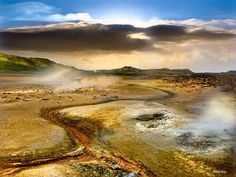 Hverir, geothermal region, north east Iceland..Iceland is a haven for surreal landscapes, one of which is the Hverir – a geothermal field to the east of Reykjahlid. The area is fairly active, with mudpots and sulphurous puddles bubbling and steaming away. A photographers dream, you will also see boiling springs, fumaroles and vents.