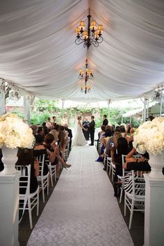 Doing the outdoor ceremony under a tent. I love the look of this... and the fans on the top are a MUST!!!
