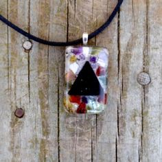 Balance Orgone Pendant - Its universal geometric shape is recognized for concentrating and transmitting energy. This pendant contains an assortment of stones which are intended to clear, harmonize and spread out the flow of energy to various chakras. Price: $46.00