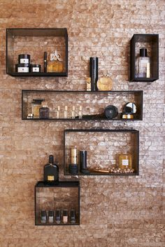 Another example of boxes as decoration and storage. I love the brick and black boxes, a great feature for displaying precious items or even a whiskey wall (for those that way inclined).