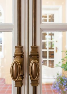 Kitchen doors designed by Rochelle Silberman with P.E. Guerin's No. 73010 Georgian Cremone in Antique Brass