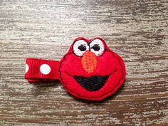 Elmo Hair Clip - Elmo Hairbow - Sesame Street Bow - Birthday Bow - Red Clip - Felt Hair Clip - Haylees Boutique by HBSouthernInspired on Etsy https://www.etsy.com/listing/203275301/elmo-hair-clip-elmo-hairbow-sesame
