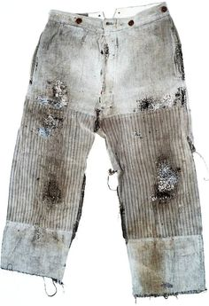 A faded pair of late nineteenth century striped trousers with patching and darning from that time.