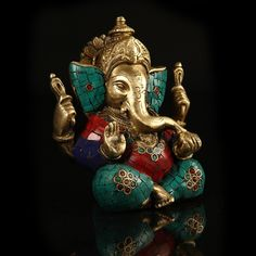 Seen here is Lord Ganesha in his most indentifiable pose, giving a blessing. Hand carved and with fine detailing, this figurine is covered with very pretty mosaic work that is an instant attention grabber while bringing peace and tranquility to your home.  http://www.indiancraftsmen.com/home-decor/brass-amp-mosaic/brass-and-mosaic-ganesha-2