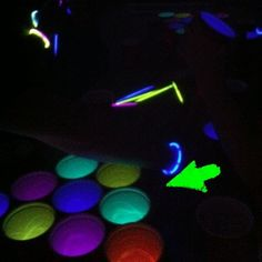 Glow Sticks in beer pong cups make for an epic glow in the dark beer pong game. #collegeingenuity