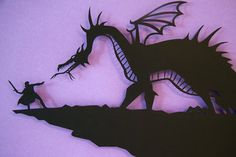 Prince Phillip vs. Maleficent as dragon 14x18 handcut paper craft by Pigg. $65.00, via Etsy.