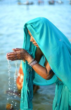 People of India, January 2013. Woman in prayer in the waters of the Sangam during the Kumbh Mela in Allahabad.